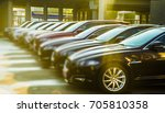 luxury modern Cars For Sale Stock Lot Row. Car Dealer Inventory. Cars For Sale Stock Lot Row. Car Dealer Inventory. sunset sun rays light. sun beam - stock photo
