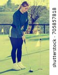 glad woman playing golf is... | Shutterstock . vector #705857818