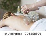 young woman getting treatment... | Shutterstock . vector #705868906
