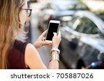 woman holding a smart phone... | Shutterstock . vector #705887026