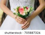 bride holding a gorgeous bouquet | Shutterstock . vector #705887326