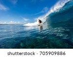 muscular surfer riding on big... | Shutterstock . vector #705909886