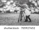 cute little girl takes picture... | Shutterstock . vector #705927652