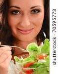 Young smiling woman holding salad bowl with variety of fresh raw vegetables. Eating food - stock photo
