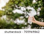 hand holding water bottle in... | Shutterstock . vector #705969862