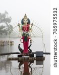 Small photo of Statue of Shakti in a hindu temple (Grand Basin), in the day with fog ,mystical atmosphere.Mauritius