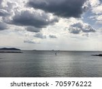 seaside  cloudy weather | Shutterstock . vector #705976222