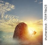 businessman climb a mountain to ... | Shutterstock . vector #705978625