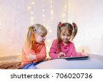 cute little girls play in... | Shutterstock . vector #706020736