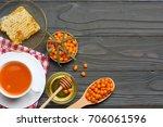 sea buckthorn in wooden bowl ... | Shutterstock . vector #706061596