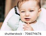 baby holding smartphone. family ... | Shutterstock . vector #706074676