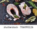 steak of white fish on a black... | Shutterstock . vector #706090126