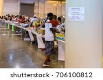 Small photo of Houston, Texas, August 30, 2017: Another shelter opens at NRG Center as refugees seek safety in Houston. A flood evacuee holding a small child receives necessary supplies