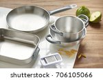 aluminum pans in the kitchen | Shutterstock . vector #706105066