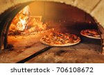 italian pizza is cooked in a... | Shutterstock . vector #706108672