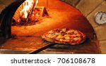 italian pizza is cooked in a... | Shutterstock . vector #706108678