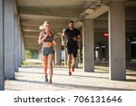 athletic couple running at the... | Shutterstock . vector #706131646