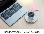 a cup of black coffee with... | Shutterstock . vector #706160536