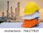 safety helmet stacked oil...   Shutterstock . vector #706177825