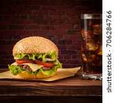 delicious cheeseburger with... | Shutterstock . vector #706284766
