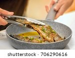 chef preparing delicious fishes ... | Shutterstock . vector #706290616