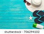flip flops on wooden background   Shutterstock . vector #706294102