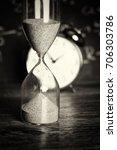hourglass against on wooden... | Shutterstock . vector #706303786