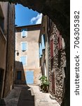 Small photo of Medieval architecture in southern european style. Characteristic style features of the provence and the cote d'azur in the mountain village Die, near Valence in France