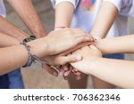 group of friends hands stacked...   Shutterstock . vector #706362346
