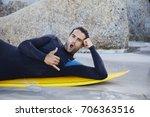 surfer dude in wetsuit... | Shutterstock . vector #706363516