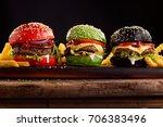 three  hamburgers on colorful... | Shutterstock . vector #706383496