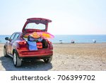 summer time and car on beach  | Shutterstock . vector #706399702