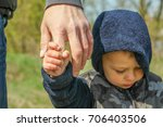 stylish hands of a parent and... | Shutterstock . vector #706403506