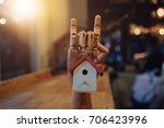 cute house wood model in hand... | Shutterstock . vector #706423996