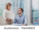 business team working on a... | Shutterstock . vector #706438825