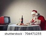 santa claus having dinner in... | Shutterstock . vector #706471255