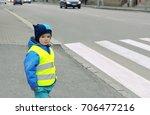 child in front of pedestrian...   Shutterstock . vector #706477216