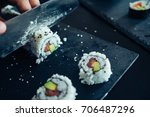 sushi being cut on a board   Shutterstock . vector #706487296