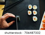 sushi being cut on a board   Shutterstock . vector #706487332
