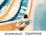 kid having fun on the water... | Shutterstock . vector #706499548