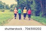 elderly woman practicing nordic ... | Shutterstock . vector #706500202