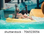 couple having fun on the water... | Shutterstock . vector #706523056