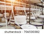 rolls of industrial cotton... | Shutterstock . vector #706530382