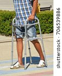 Small photo of Man with a walker on the street