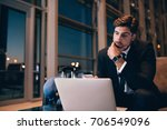 young businessman waiting at... | Shutterstock . vector #706549096
