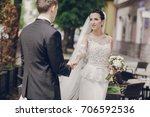 the bride and groom walking... | Shutterstock . vector #706592536