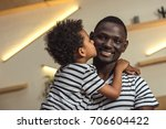 adorable little son hugging and ... | Shutterstock . vector #706604422
