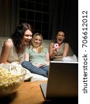 three young women watching a... | Shutterstock . vector #706612012