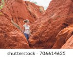 young woman in red canyon near... | Shutterstock . vector #706614625