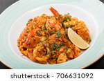 seafood paella with rice ... | Shutterstock . vector #706631092